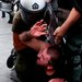 The police detained a protester during clashes in Athens on Wednesday over austerity measures imposed because of Greek debt.